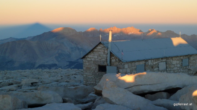 This is the end. The top of Mt. Whitney with its shadow on the left. The downside: no drinks were served in the hut.